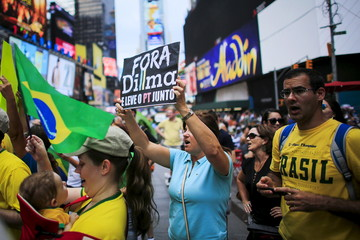 Demonstrators attend a protest against Brazil's President Rousseff at Times Square in New York