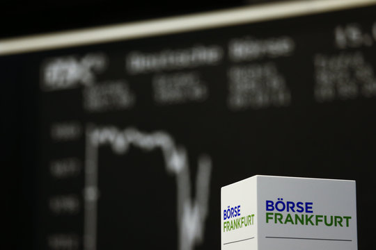 A box with text 'Frankfurt stock exchange' is pictured in front of the German share price index DAX board at the Frankfurt stock exchange