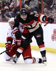 Carolina Hurricanes' Faulk collides with Ottawa Senators' Smith during the second period of their NHL hockey game in Ottawa