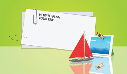 yacht with red sails floats on the screen white tablet white blank note with paper clip