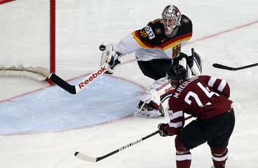 Latvia's Redlihs scores against Germany's goaltender Grubauer during the second period of their men's ice hockey World Championship group B game at Minsk Arena in Minsk