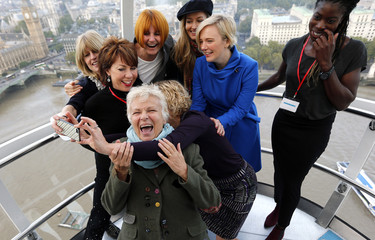Actress Julie Walters laughs as she poses for a selfie with her fellow mentors in the London Eye, during an event with girls from the Dunraven School to mark the third UN International Day of the Girl in central London