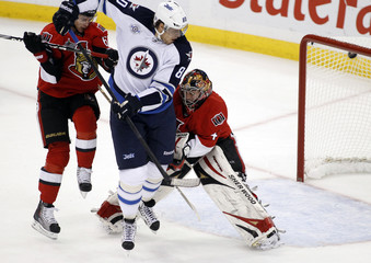 Winnipeg Jets' Antropov screens Ottawa Senators' Karlsson and Anderson during a goal in the first period of their NHL hockey game in Ottawa