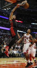 Toronto Raptors' Valanciunas dunks the ball over Chicago Bulls' Thomas during the second half of their NBA basketball game in Chicago, Illinois