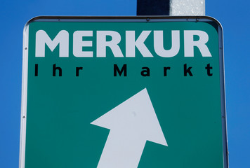 The logo of Merkur supermarket is seen on a road sign in Vienna
