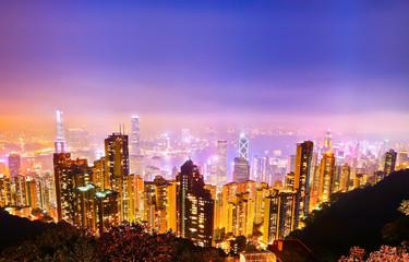 Victoria Harbor and Hong Kong skyline at night.