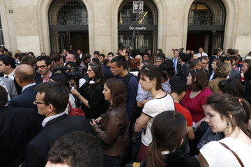 Some one hundred people, principally students from Science Po (Political Science Institute), gather in the street outside the entrance of the school in Paris