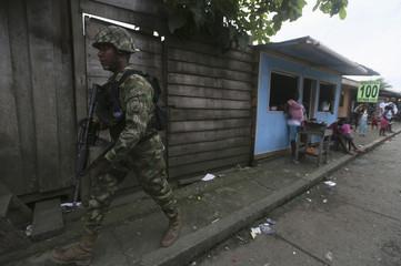 "Colombian Special Forces soldier patrols a street in ""La Playita"" neighbourhood in port city of Buenaventura"