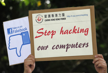 """A demonstrator from the pro-China """"Caring Hong Kong Power"""" group protests outside the U.S. Consulate in Hong Kong"""