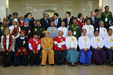 Myanmar's President Thein Sein, government officials, ethnic rebel groups and international witnesses pose for a picture after the signing ceremony of the Nationwide Ceasefire Agreement in Naypyitaw, Myanmar