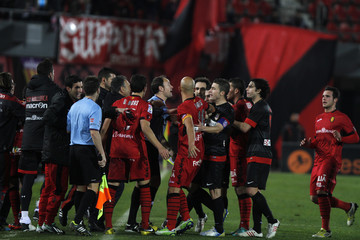 Atletico Madrid and Mallorca players argue during their Spanish first division soccer match at Iberostar stadium in Mallorca