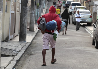A man suspected by municipal agents to be a crack user walks away during an operation in the Madureira neighborhood, in Rio de Janeiro