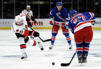 Rangers McDonagh  blocks a shot by Senators Karlsson during Game 2 of their NHL Eastern Conference quarter-final playoff hockey game at Madison Square Garden in New York