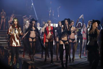 Models present creations during the Etam Live Show Lingerie at Bourse du Commerce during Paris fashion