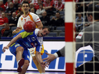 Slovenia's Zorman attempts to score against Macedonia's goalkeeper Ristovski during their men's European Handball Championship match for the fifth place in Belgrade