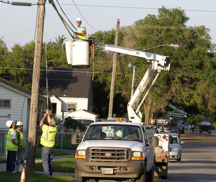 Phone company workers string up new fiber optic cable after flooding damaged the old cable near the Souris River in Minot, North Dakota