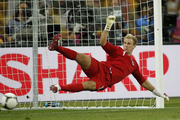 England's Hart dives the wrong way for Italy's Diamanti to score the winning penalty in a penalty shoot-out during their Euro 2012 quarter-final soccer match at the Olympic Stadium in Kiev