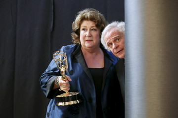 Martindale and Freeman wait to pose for photos backstage at the 2015 Creative Arts Emmy Awards in Los Angeles