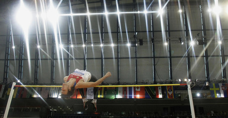 Russia's Ukhov competes during the men's high jump event at the IAAF World Indoor Athletics Championships at the Aspire Dome in Doha
