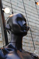Black dummy, female mannequin with lightbulbs