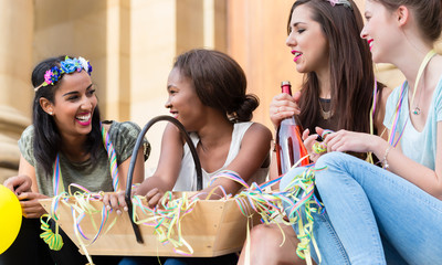 Girls having drink together on bachelorette party
