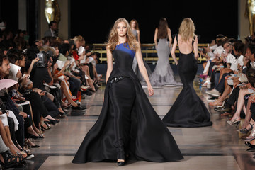 Models present creations by French designer Stephane Rolland as part of his Fall/Winter 2010-2011 Haute Couture fashion show in Paris