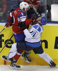 Norway's Holtet collides with Finland's Kukkonen during their quarter-final match at the Ice Hockey World Championships in Bratislava