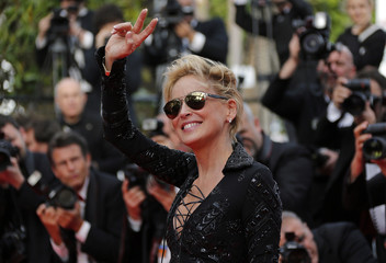 """Actress Sharon Stone poses on the red carpet as she arrives for the screening of the film """"The Search"""" in competition at the 67th Cannes Film Festival in Cannes"""