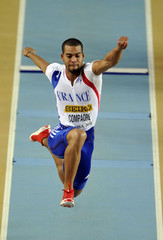Compaore of France competes in the men's triple jump qualification at the world indoor athletics championships in Istanbul