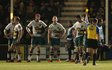 Northampton Saints' Calum Clark is shown a yellow card by Referee Greg Macdonald