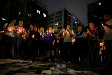 People hold a candlelight vigil to mourn victims of the mass shooting at the Pulse gay nightclub in Orlando, in Tokyo, Japan