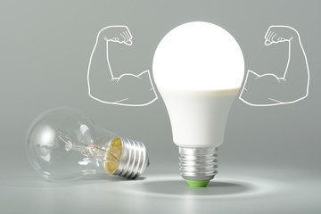 Led light bulb with inflated arms and lay next to incandescent bulb