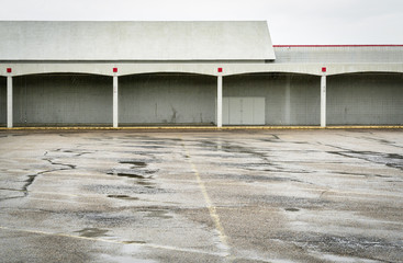 empty parking lot of a shut down mall