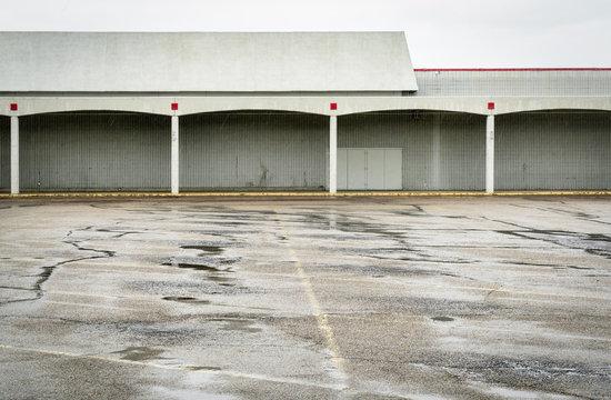 empty parking lot of a shut down mall