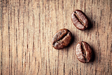 Dark Coffee Beans on Wooden Surface