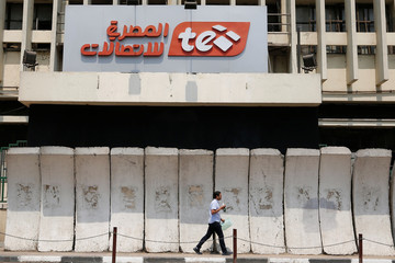 A man walks in front of the main Telecom Egypt building at the center of downtown in Cairo