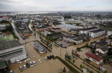 A residential area flooded by the Kinugawa river, caused by typhoon Etau, is seen in Joso, Ibaraki prefecture, Japan