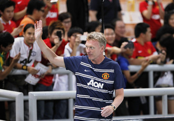 Manchester United Manager Moyes waves to fans before friendly match against Thailand Singha All Stars in Bangkok