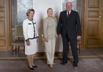 U.S. Secretary of State Clinton poses with Norway's King Harald V and Queen Sonja prior to meetings in Oslo