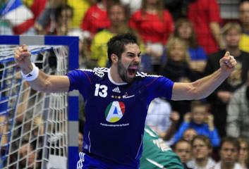 France's Karabatic celebrates after scoring against Denmark during their Men's Handball World Championship final match in Malmo