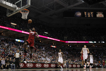 Heat' James goes in for a dunk during the first half of Game 4 of his NBA first round playoff series against the Bucks in Milwaukee