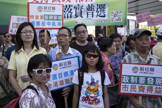 Pro-China supporters take part in a rally against the Occupy Central Movement and in support of the government's consultation report on methods for electing the Chief Executive in 2017, outside the Legislative Council in Hong Kong