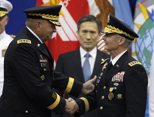 Incoming Commander General Thurman shakes hands with outgoing Commander General Sharp in Seoul