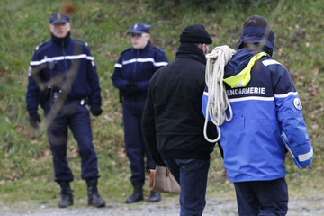 French gendarmes investigate near a pond after an unidentified body was discovered in Lavau-sur-Loire, western France