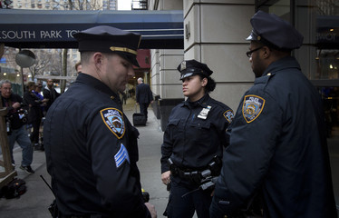 Police stand outside the South Park Tower rental apartment in Manhattan, New York