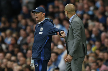 West Bromwich Albion manager Tony Pulis and Manchester City manager Pep Guardiola