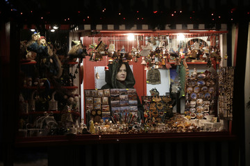 A merchant waits for customers in the Christmas market in Riga