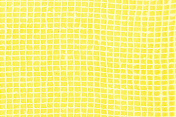 Yellow bright summer background for a postcard with white mesh. Checkered background for a postcard of yellow color.