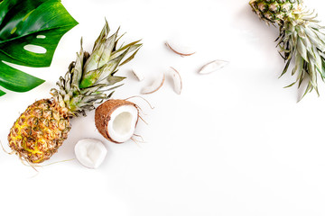 summer mix with pineapple and coconut white background top view mockup