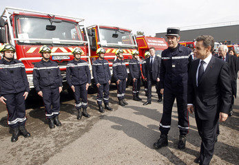 France's President Sarkozy reviews firemen after a fire exercise during the inauguration of the National high school firefighters officers in Aix en Provence